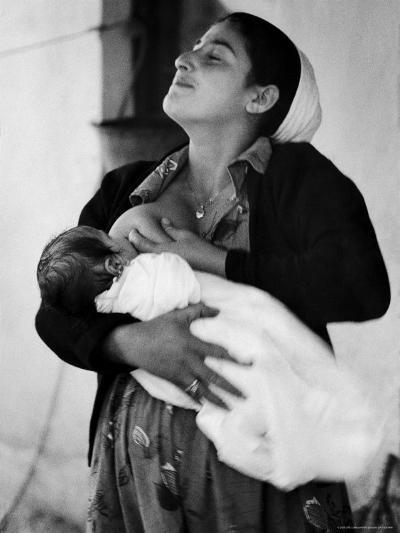 Kurdi Mother, One of the Most Primitive Tribes of Israel, Nursing Child in Mountain Colony-Paul Schutzer-Photographic Print