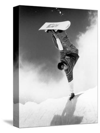 Snowboarder Doing a Handstand