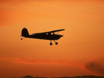 Silhouette of Small Airplane in Flight