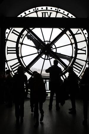 Europe, France, Paris. Clock and silhouettes at Musee D'Orsay.