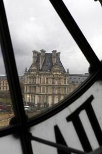 Europe, France, Paris. View of Louvre from Musee D'orsay Clock. by Kymri Wilt