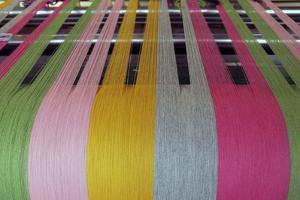 Europe, Ireland, Avoca. Avoca Handweavers Mill, County Wicklow. Woollen yarns on loom. by Kymri Wilt