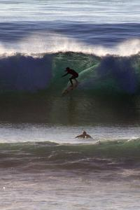 USA, California, San Diego. Surfer at Cardiff by the Sea by Kymri Wilt