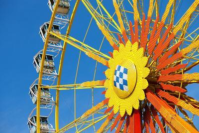 Traditional Bavarian Big Wheel on a Fair like Dult or the Oktoberfest on a Great Sunny Day with Blu