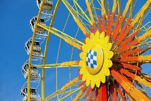 Traditional Bavarian Big Wheel on a Fair like Dult or the Oktoberfest on a Great Sunny Day with Blu by Kzenon