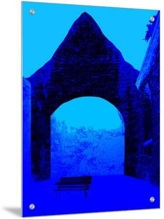 Abstract Image of a Bench and Brick Arched Structure in Blue
