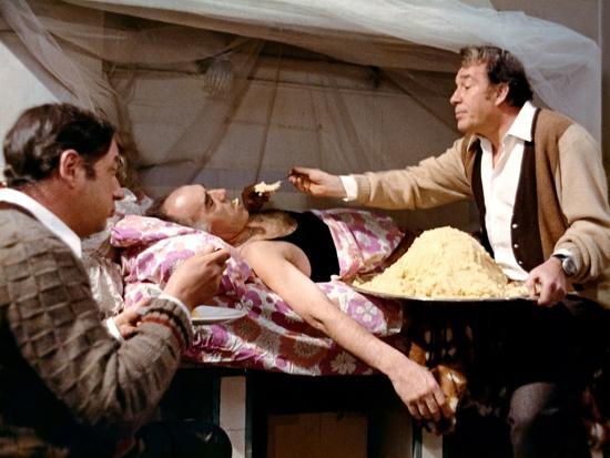 LA GRANDE BOUFFE, 1973 directed by MARCO FERRERI Philippe Noiret, Michel Piccoli and Ugo Tognazzi (--Photo