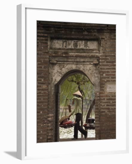 Lady Carrying Baskets, Hoan Kiem Lake, Hanoi, Northern Vietnam, Southeast Asia-Christian Kober-Framed Photographic Print
