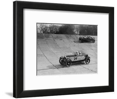 Lagonda and Alfa Romeo on the banking at the JCC Double Twelve Race, Brooklands, Surrey, 1929-Bill Brunell-Framed Photographic Print