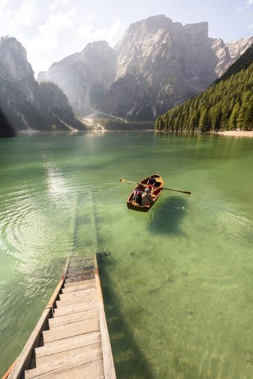 Lake Prags, Prags Dolomites, S Tyrol, Italy: People In Rowing Boat Rowing Out From Rental Station-Axel Brunst-Photographic Print