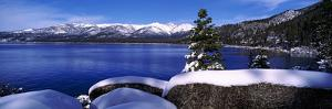 Lake with a Snowcapped Mountain Range in the Background, Sand Harbor, Lake Tahoe, California, USA