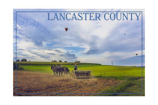 Lancaster County, Pennsylvania - Amish Farmer and Hot Air Balloons-Lantern Press-Art Print