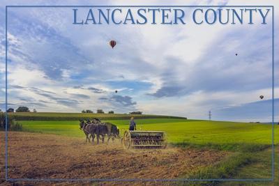 https://imgc.artprintimages.com/img/print/lancaster-county-pennsylvania-amish-farmer-and-hot-air-balloons_u-l-q1gqhzp0.jpg?p=0