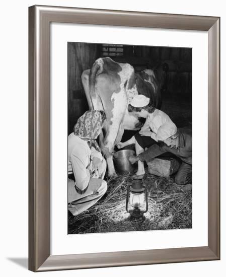 Land Girls Millking Cows on a Farm During World War II-Robert Hunt-Framed Photographic Print