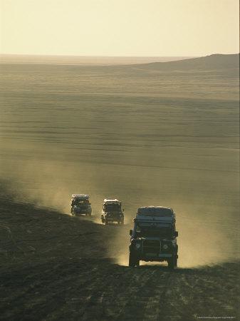 https://imgc.artprintimages.com/img/print/land-rovers-kick-up-dust-on-the-old-caravan-road-to-ghat_u-l-p5x8kh0.jpg?p=0