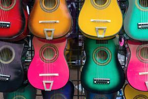 Acoustic Guitars on Wall by Lantern Press