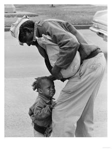 African American Man Comforts Crying Child Photograph by Lantern Press