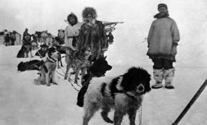 Alaska - Dog Sled Team and Men in Parkas by Lantern Press