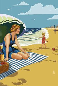 Beach Scene with Woman by Lantern Press