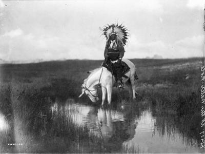 Cheyenne Indian, Wearing Headdress, on Horseback Photograph