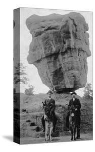 Colorado Springs, CO - Garden of Gods Balanced Rock, Men on Burros by Lantern Press