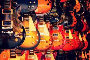 Electric Guitars on Wall by Lantern Press