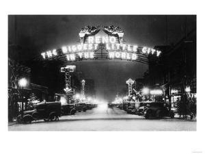 Famous Reno Entrance Sign Lit Up at Night - Reno, NV by Lantern Press