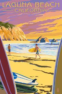 Laguna Beach, California - Surfers at Sunset by Lantern Press
