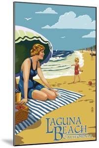 Laguna Beach, California - Woman on the Beach by Lantern Press