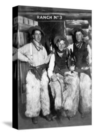 Men Dressed as Cowboys with Bottles of Whiskey