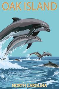 Oak Island, North Carolina - Dolphins Jumping by Lantern Press