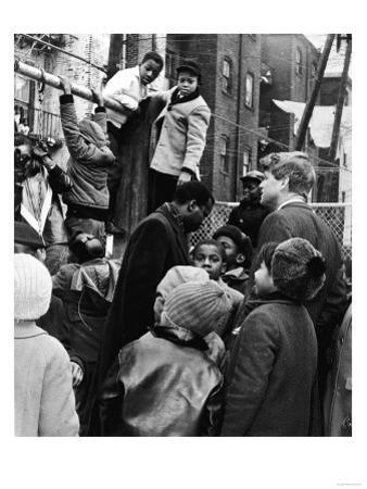 Robert Kennedy with Children at Playground Photograph - New York, NY by Lantern Press