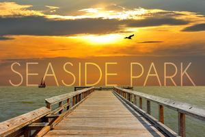 Seaside Park, New Jersey - Pier at Sunset by Lantern Press