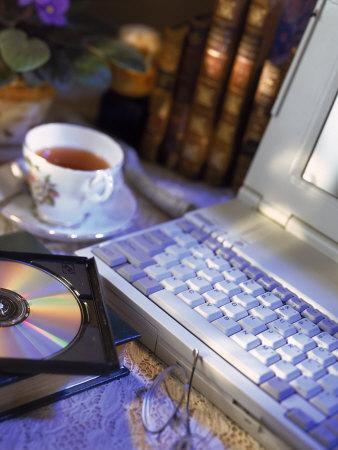 https://imgc.artprintimages.com/img/print/laptop-computer-cd-rom-cup-of-tea-and-books_u-l-p3ina00.jpg?p=0