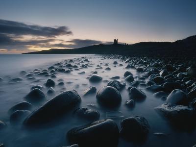 Large Boulders on Beach Near Dunstanburgh Castle at Dawn-Design Pics Inc-Photographic Print