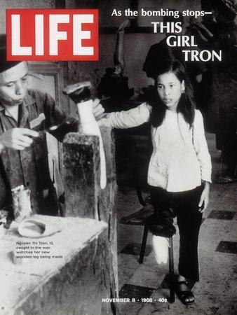 12-Year-Old Vietnamese Girl Nguyen Thi Tron Watching New Wooden Leg Being Made, November 8, 1968
