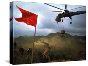 1st Air Cavalry Skycrane Helicopter Delivering Ammunition and Supplies to US Marines by Larry Burrows