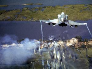 American F-4C Phantom Jet Streaming Contrails After Bombing Viet Cong Stronghold During Vietnam War by Larry Burrows
