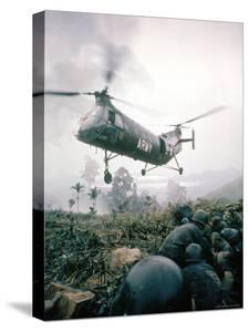 American Helicopter H-21 Hovering Above Soldiers in Combat Zone During Vietnam War by Larry Burrows