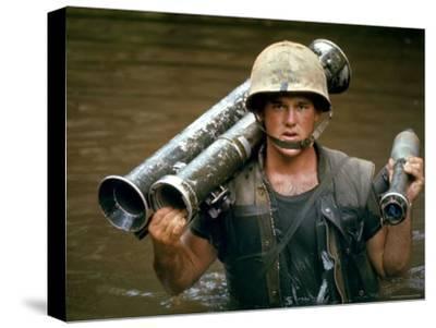 American Marine Pfc. Phillip Wilson Carrying Bazooka Across Stream Near DMZ During Vietnam War
