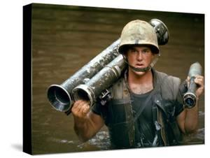 American Marine Pfc. Phillip Wilson Carrying Bazooka Across Stream Near DMZ During Vietnam War by Larry Burrows