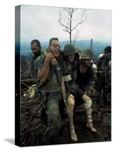 American Marines Aid a Wounded Comrade During Intense Battle for Hill 484 by Larry Burrows