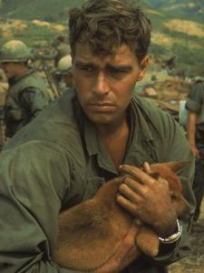 American Soldier Cradling Dog While under Siege at Khe Sanh by Larry Burrows