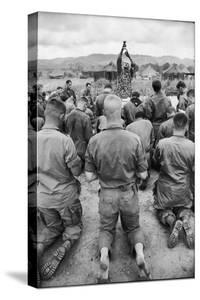 Capt. Bill Carpenter and Members of the 101st Airborne at Outdoor Catholic Mass, Vietnam, 1966 by Larry Burrows