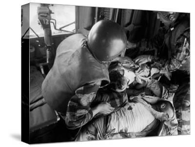 Cpl. James Farley and Pfc. Wayne Hoilien Bandaging Sgt. Billie Owens' Shoulder, Yankee Papa 13