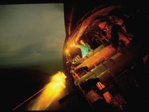 Crew of American AC47 Gunship Firing 7.62 MM Miniguns on a Night Mission During the Vietnam War by Larry Burrows