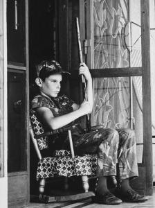 Dennis Driscoll, Son of Lt. Colonel Arthur Driscoll at front door After Viet Cong Bombings by Larry Burrows