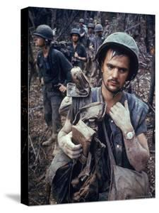 Dirty, Exhausted Looking US Marine on Patrol with His Squad Near the DMZ During the Vietnam War by Larry Burrows