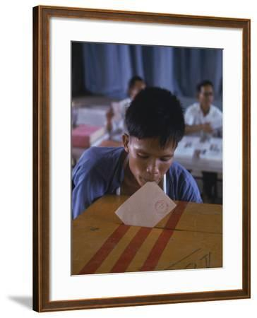 Disabled South Vietnamese Soldier Casting a Vote into a Ballot Box at Cong Hoa Army Hospital