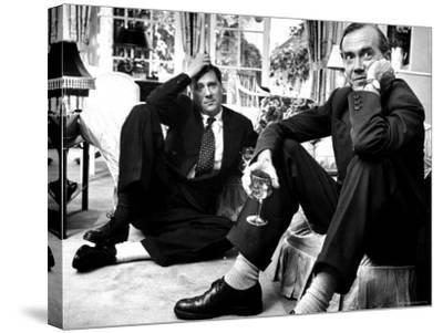 Film Director Carol Reed and Author Graham Greene Sitting on the Floor with Wine Glasses